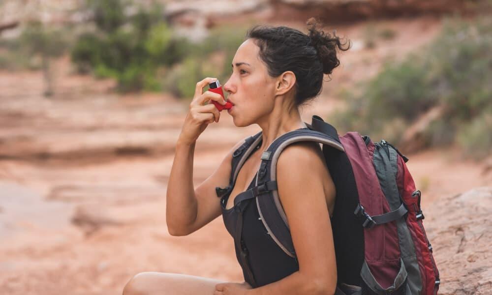 Trekker using an inhaler